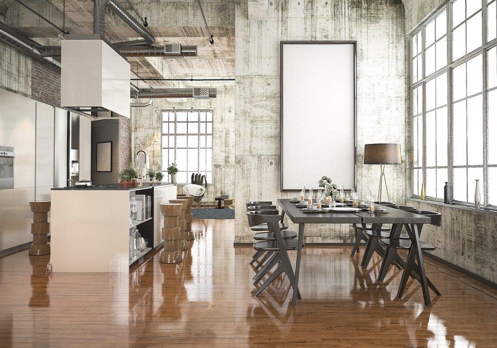 Kuchyňa zariadená v priemyselnom štýle so stenami zo surového materiálu a veľkým dreveným stolom