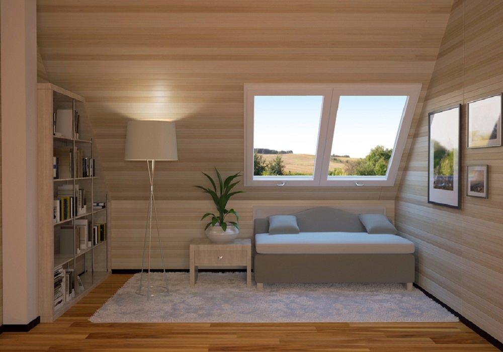 Pohovka pod oknom v podkroví s obkladom na stenách